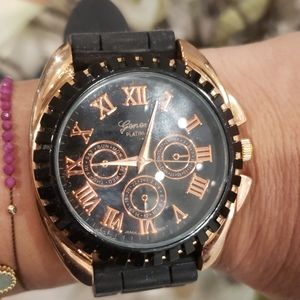 Geneva watch with rose gold accent.
